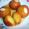 sobzees indian gulab jamun doughnut like balls soaked in syrup recipe main photo