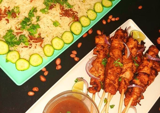 Chicken satay with peanut sauce and mixed vegetable rice